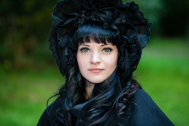 A girl in black Vicotrian clothing attends the traditional park picnic on the first day of the annual Wave-Gotik Treffen, or Wave and Goth Festival, on May 17, 2013 in Leipzig, Germany. The four-day festival, in which elaborate fashion is a must, brings together over 20,000 Wave, Goth and steam punk enthusiasts from all over the world for concerts, readings, films, a Middle Ages market and workshops. (Photo by Marco Prosch)
