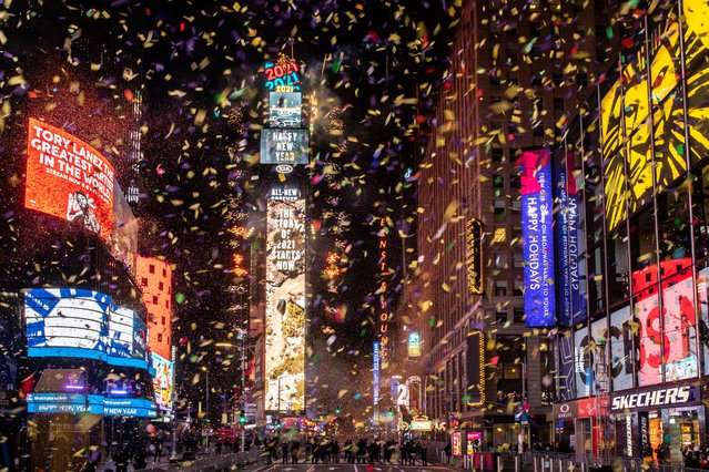 Confetti flies around the ball and countdown clock in Times Square during the virtual New Year's Eve event in Manhattan, New York, January 1, 2021. (Photo by Jeenah Moon/Reuters)