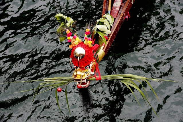 The front of one of the dragon boats, during the Aberdeen Dragon Boat Races in Hong Kong.  (Photo by Jessica Hromas/Getty Images)