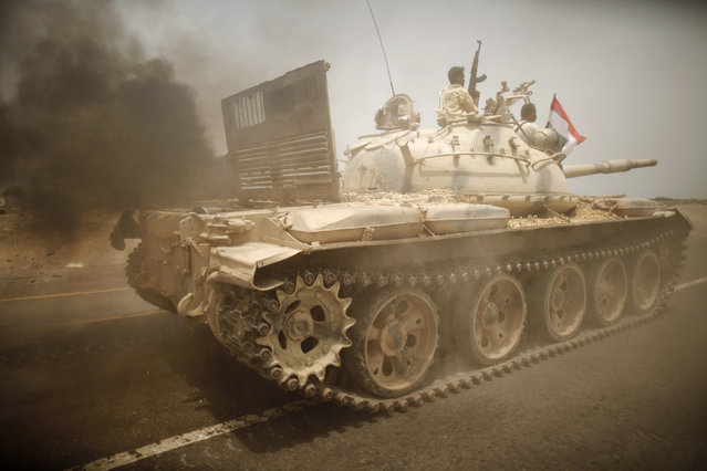 An army tank is driven on a road near the southern Yemeni city of Zinjibar June 14, 2012. (Photo by Khaled Abdullah/Reuters)