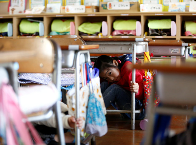 School children take shelter under desks during a tsunami simulation drill ahead of World Tsunami Awareness Day at Futaba elementary school in Choshi, Chiba Prefecture, Japan, November 4, 2016. (Photo by Kim Kyung-Hoon/Reuters)