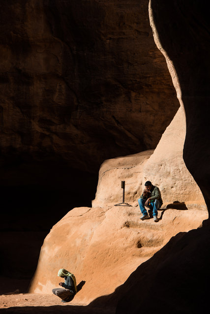 """""""Resting"""". A couple of Beduins are just resting in a ray of the Sun in the Siq, the canyon leading to Petra City in Jordan. (Photo and caption by Jeremie Noel/National Geographic Traveler Photo Contest)"""