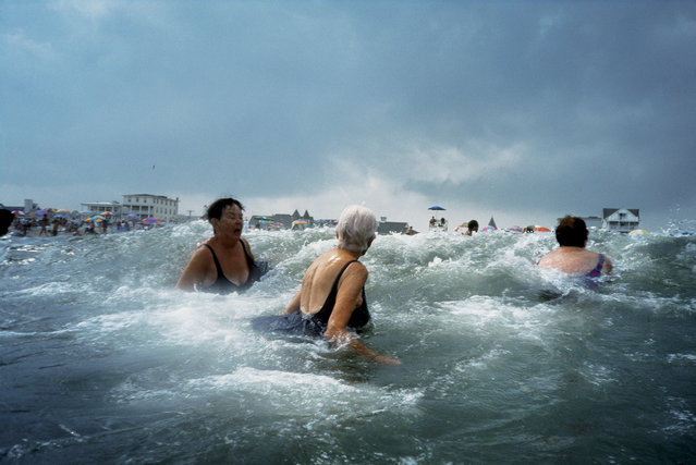 Longtime Ocean Grove visitors take a dip in the roiling Atlantic surf in New Jersey in 2003. (Photo by Amy Toensing/National Geographic)
