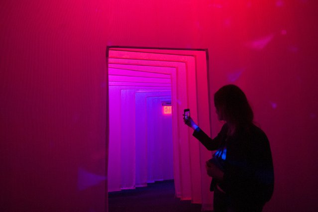 A person take a mobile phone photo of a corridor between galleries at the Museum of Feelings, a pop-up installation in New York, December 15, 2015. (Photo by Stephanie Keith/Reuters)