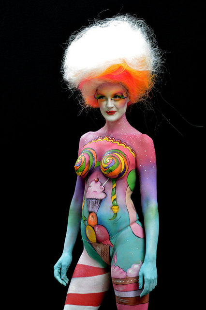 A participant poses with her body paintings designed by bodypainting artist Birgit Rhomberg during the 16th World Bodypainting Festival enter caption here on July 5, 2013 in Poertschach am Woerthersee, Austria. (Photo by Didier Messens/Getty Images)