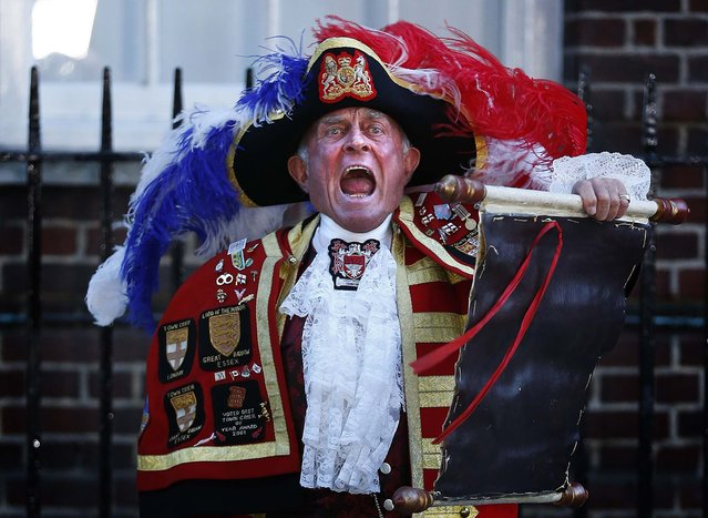 Tony Appleton, a town crier, announces the royal birth outside the Lindo Wing of St Mary's Hospital after Catherine, Duchess of Cambridge gave birth to a baby boy in central London July 22, 2013. Prince William's wife Kate gave birth on Monday to a baby boy, in the Lindo Wing of St Mary's Hospital, who becomes third in line to the British throne, his office said. The royal baby, the couple's first child, was born at 4:24 p.m. (15:24 GMT), weighing 8 lbs and 6 oz. (Photo by Lefteris Pitarakis/Associated Press)
