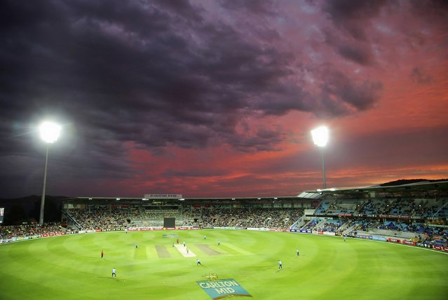 A general view shows the One Day International (ODI) tri-series cricket match between Australia and England in the field as the sun sets at Bellerive Oval in Hobart, Tasmania January 23, 2015. (Photo by Hamish Blair/Reuters)