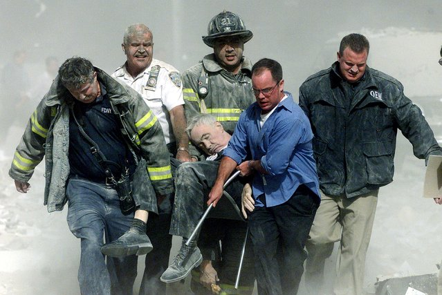 Rescue workers carry fatally injured New York City Fire Department Chaplain, Fether Mychal Judge, from one of the World Trade Center towers in New York, September 11, 2001. Shannon Stapleton: I will never forget the phone call from my bureau chief on the morning of September 11, 2001. (Photo by Shannon Stapleton/Reuters)