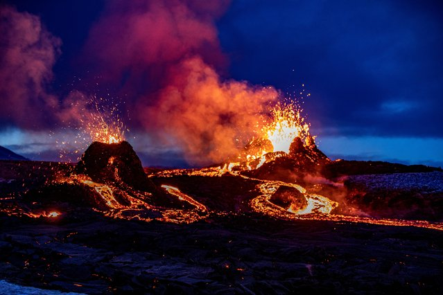 Lava oozes from a new fissure near Fagradalsfjall, Iceland on April 5, 2021. Two new fissures have opened in the Icelandic volcano that has attracted thousands of visitors since erupting three weeks ago. (Photo by Ao Thor via Reuters)