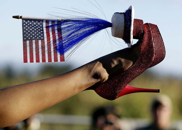 Miss District of Columbia Bindhu Pamarthi  displays her shoe during the Miss America Shoe Parade. (Photo by Julio Cortez/Associated Press)