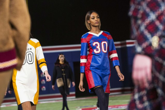 A model presents a creation from the Tommy Hilfiger Fall/Winter 2015 Collection at the New York Fashion Week February 16, 2015. Shunning the traditional catwalk, Mr. Hilfiger instead presented his collection on a mock American Football field. (Photo by Andrew Kelly/Reuters)