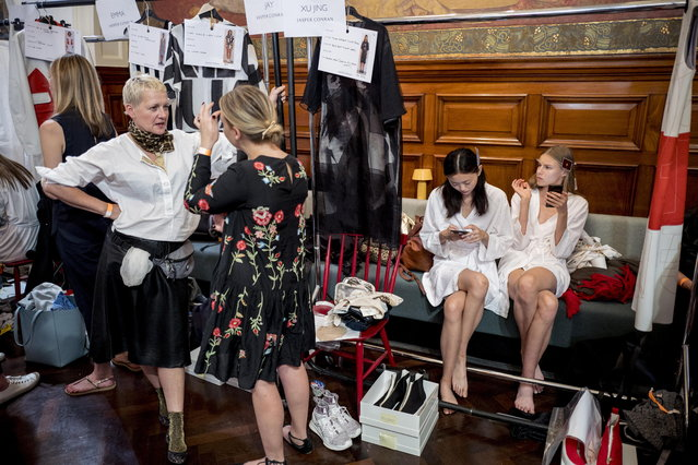 Models get ready backstage ahead of a show of British designer Jasper Conran at the London Fashion Week, in London, Britain, 15 September 2018. (Photo by Tolga Akmen/EPA/EFE)