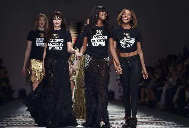 British models Naomi Campbell (2nd R) and Jourdan Dunn (R) wear campaign against Ebola tee-shirts during the Fashion for Relief charity catwalk show ahead of London Fashion Week in London February 19, 2015. (Photo by Toby Melville/Reuters)