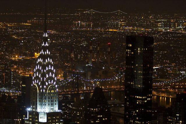 The Chrysler building (L) is seen from the observation level of the Empire State Building in the Manhattan borough of New York February 4, 2015. (Photo by Carlo Allegri/Reuters)