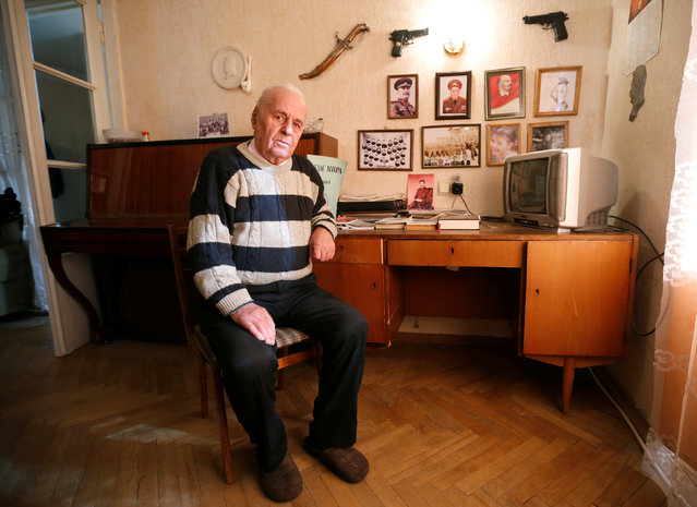 """Levan Gongadze, 87, poses for a portrait at his home in Tbilisi, Georgia, November 28, 2016. """"I have been a fan of Stalin all my life, but there was a time when I almost changed my mind. It was after the 20th Congress of the Communist Party (of the Soviet Union in 1956) when Nikita Krushchev denounced the personality cult and dictatorship of Josef Stalin. But later I realised they weren't right"""", Gongadze said. (Photo by David Mdzinarishvili/Reuters)"""
