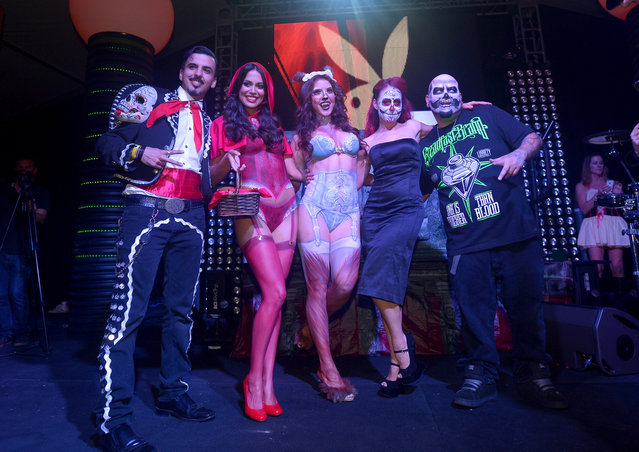 Playmate of the Year Raquel Pomplun (2nd L), Playmate Amanda Cerny (C) and the cast of Syfy's Naked Vegas pose onstage at Playboy Mansion's annual Halloween bash on October 26, 2013 in Holmby Hills, California. (Photo by Charley Gallay/Getty Images for Playboy)