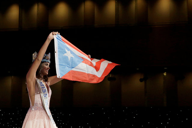 Miss Puerto Rico Stephanie Del Valle holds up the Puerto Rican flag after winning the Miss World 2016 Competition in Oxen Hill, Maryland, U.S., December 18, 2016. (Photo by Joshua Roberts/Reuters)