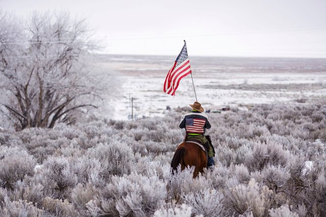 Duane Ehmer rides his horse Hellboy at the occupied Malheur National Wildlife Refuge on the sixth day of the occupation of the federal building in Burns, Oregon, on January 7, 2016. (Photo by Rob Kerr/AFP Photo)