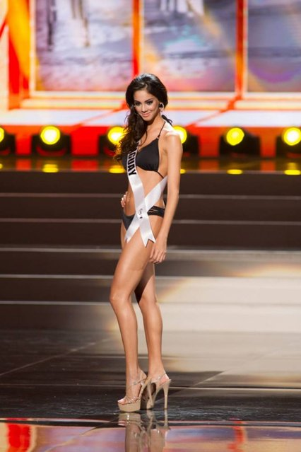 A handout picture provided by the Miss Universe Organization shows Guadalupe Gonzalez, Miss Paraguay 2013, competing in the swimsuit competition during the Preliminary Competition at the Crocus City Hall, in Moscow, Russia, 05 November 2013. (Photo by Darren Decker/EPA)