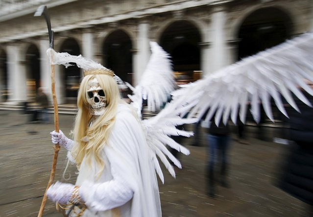 A masked reveller poses in San Marco Piazza during the Venice Carnival, January 30, 2016. (Photo by Alessandro Bianchi/Reuters)