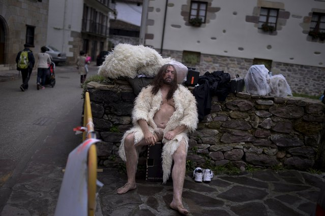 A man dressed in sheepskin smokes a cigarette during carnival celebrations in Ituren February 1, 2016. (Photo by Vincent West/Reuters)