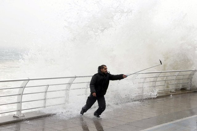 A man takes a selfie by a crashing wave on Beirut's Corniche, a seaside promenade, as high winds sweep through Lebanon during a storm, in this February 11, 2015 file photo. (Photo by Mohamed Azakir/Reuters)