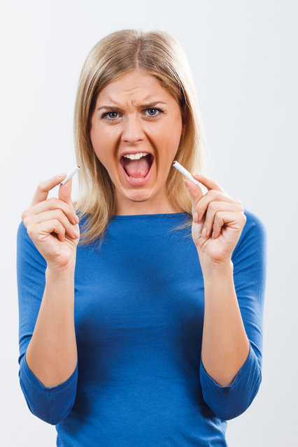 Young woman is very angry because of her addiction to cigarettes and she decided to break this bad habit. (Photo by LittleBee80/Getty Images/iStockphoto)