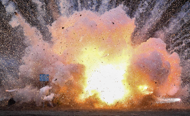Illegal firecrackers are being detonated in a controlled explosion on December 10, 2018 in Weisskeissel, eastern Germany, close to the Polish border. (Photo by Patrick Pleul/DPA/AFP Photo)