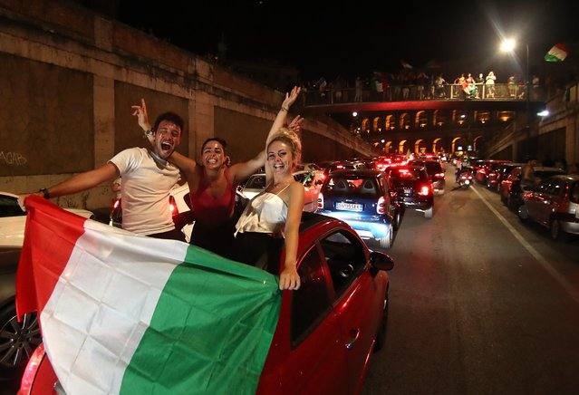 People celebrate the victory of the final of EURO 2020 Italy vs England on July 11, 2021 in Rome, Italy. Italy's men's team claimed victory over England in the UEFA EURO 2020 final at Wembley Stadium this evening, winning the tournament for the first time since they hosted the competition in 1968. (Photo by Yara Nardi/Reuters)