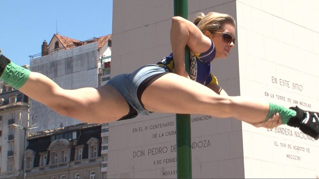 A participant in the Miss Pole Dance South America 2013 competition performs in in front of the obelisk in Republica Square in downtown Buenos Aires on November 22, 2013 ahead of the contest to be held on November 23 and 25 in the city. (Photo by Juan Mabromata/AFP Photo)