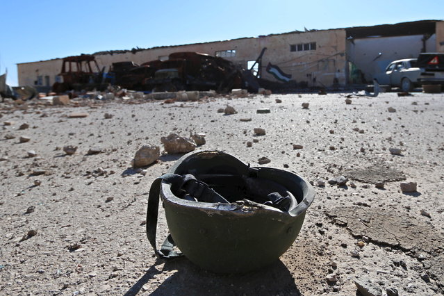 A helmet belonging to a Islamic State militant is seen on the ground at the 121 Regiment base after Fighters from the Democratic Forces of Syria took control of the base in the town of al-Melabiyyah, south of Hasaka city, November 24, 2015. (Photo by Rodi Said/Reuters)