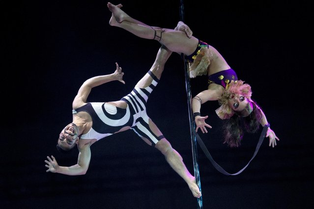 Philippines' Kayleen Ortiz and Emmanuel Lgnacio compete at the 2015 World Pole Dance Championships held in Beijing, Sunday, April 12, 2015. (Photo by Ng Han Guan/AP Photo)