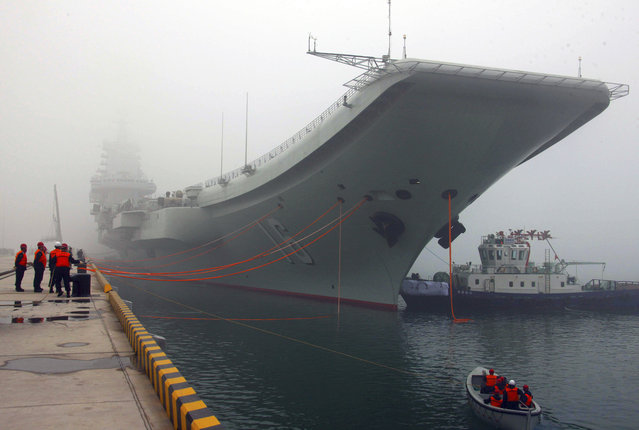 In this February 27, 2013 file photo released by China's Xinhua news agency, China's first aircraft carrier, the Liaoning, is anchored in the northern port in Qingdao, east China's Shandong Province. Taiwan's defense ministry said China's sole aircraft carrier on Wednesday, January 11, 2017 was transiting the Taiwan Strait amid heightened tensions between the mainland and self-governing island it claims as its own territory. (Photo by Wu Dengfeng/Xinhua via AP Photo)