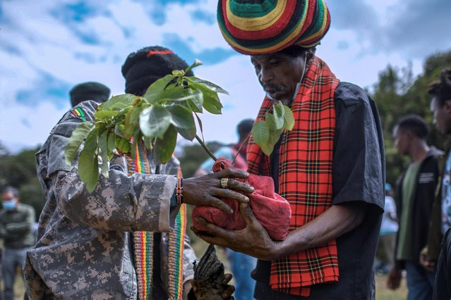 Adherents of the rastafari sect, known as the Rastafari Society of Kenya, plant tree seedlings in commemoration of the birthday of Jamaican black empowerment activist, Marcus Garvey, at Oloolua Forest in Ngong on August 17, 2021. Although Garvey never actually followed Rastafari or believed in it, he is considered to be one of the religion's prophets, because it was his ideologies that eventually grew into the Rastafari faith. (Photo by Tony Karumba/AFP Photo)