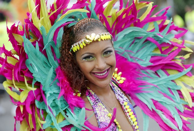 A reveler takes part during the Jamaica Carnival Road march in Kingston April 12, 2015. (Photo by Gilbert Bellamy/Reuters)