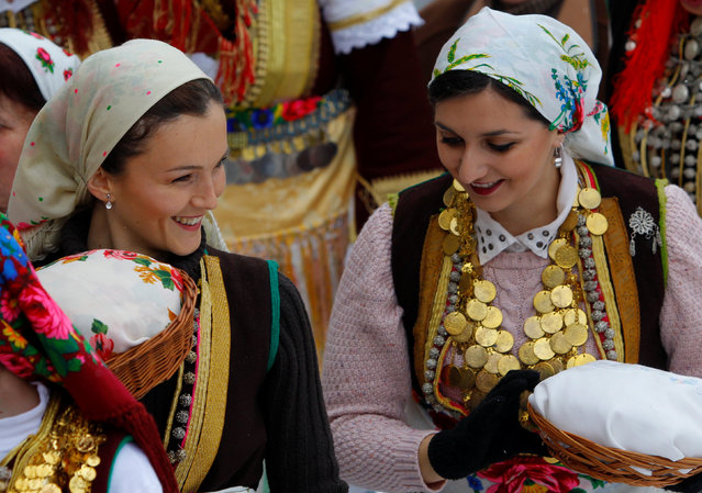 Women dressed in traditional folk costumes participate at the Epiphany day celebration in Bitushe village, Macedonia January 19, 2017. (Photo by Ognen Teofilovski/Reuters)