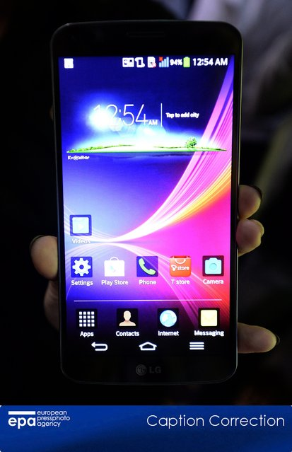 The LG G Flex phone is shown during the Unveiled press preview event for the 2014 International Consumer Electronics Show (CES) at the Mandalay Bay Convention Center in Las Vegas, Nevada, USA, 05 January 2014. The company touts the unit as the world's first curved flexible smart phone featuring a six-inch (15 cm) curved P-OLED screen. (Photo by Michael Nelson/EPA)