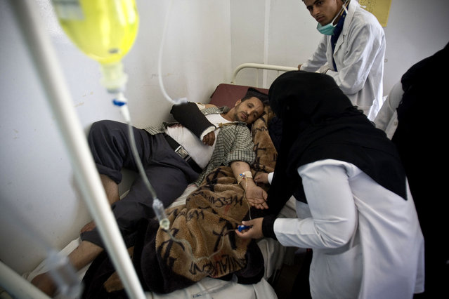 Medics treat an injured man from recent a Saudi-led airstrike, at a hospital in Sanaa, Yemen, Tuesday, April 21, 2015. The Saudi-led coalition pounded Shiite rebels in Yemen on Tuesday, killing at least 19 in a city in the country's west, officials said. (Photo by Hani Mohammed/AP Photo)