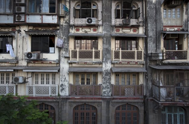 Facades of different old residential buildings are seen in south Mumbai March 15, 2015. The cost for buying a residential apartment in Mumbai close to the city centre ranges from 12,000 Indian rupees ($ 200) per square feet to 112,552 Indian rupees ($ 1800) per square feet. (Photo by Danish Siddiqui/Reuters)