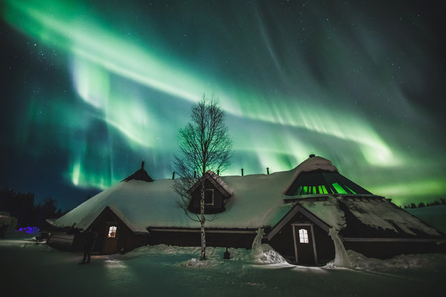 The Aurora Borealis (Northern Lights) is seen in the sky over Arctic Snowhotel in Rovaniemi, Finland on February 28, 2019. (Photo by Alexander Kuznetsov/Reuters)
