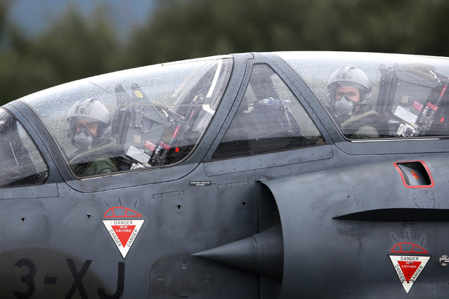 French Air Force pilots prepare to take off on a Mirage 2000 fighter jet during the close air support (CAS) exercise Serpentex 2016 hosted by France in the Mediterranean island of Corsica, at Solenzara air base, March 17, 2016. (Photo by Charles Platiau/Reuters)