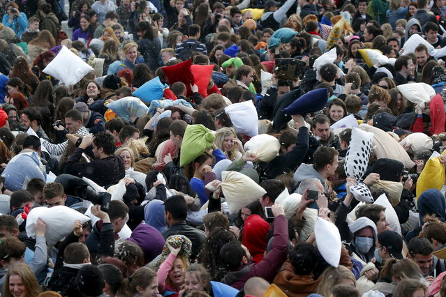 People fight with pillows during International Pillow Fight Day at Heroes Square in Budapest April 4, 2015. (Photo by Laszlo Balogh/Reuters)