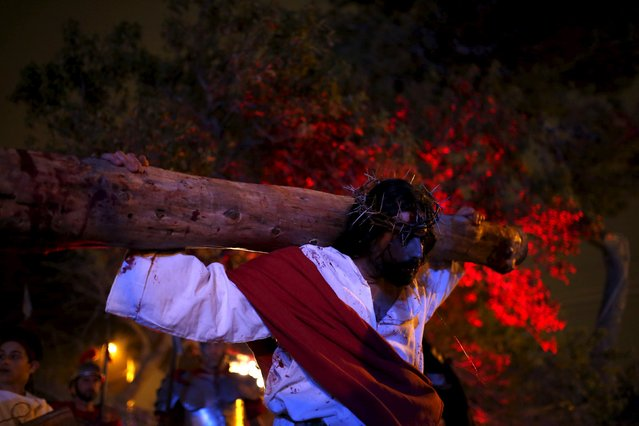 "An actor portraying Jesus Christ takes part in the interactive street-theatre Passion play ""Il-Mixja"" (The Way), one of a series of Holy Week activities in the run-up to Easter, in the grounds of Mount Carmel Mental Hospital in Attard, outside Valletta, Malta, March 22, 2016. (Photo by Darrin Zammit Lupi/Reuters)"