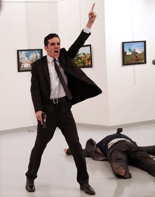 A handout photo made available by the World Press Photo (WPP) organization on 13 February 2017 shows a picture by The Associated Press photographer Burhan Ozbilici that won the Spot News – First Prize, Stories award of the 60th annual World Press Photo Contest, it was announced by the WPP Foundation in Amsterdam, The Netherlands on 13 February 2017. Caption: Mevlut Mert Altintas shouts after shooting Andrey Karlov, the Russian ambassador to Turkey, at an art gallery in Ankara, Turkey. Story: Mevlut Mert Altintas, a 22-year-old off-duty police officer, assassinated the Russian ambassador to Turkey, Andrey Karlov, at an art exhibition in Ankara, Turkey, on 19 December 2016. He wounded three other people before being killed by officers in a shootout. (Photo by Burhan Ozbilici/AP Photo/World Press Photo)