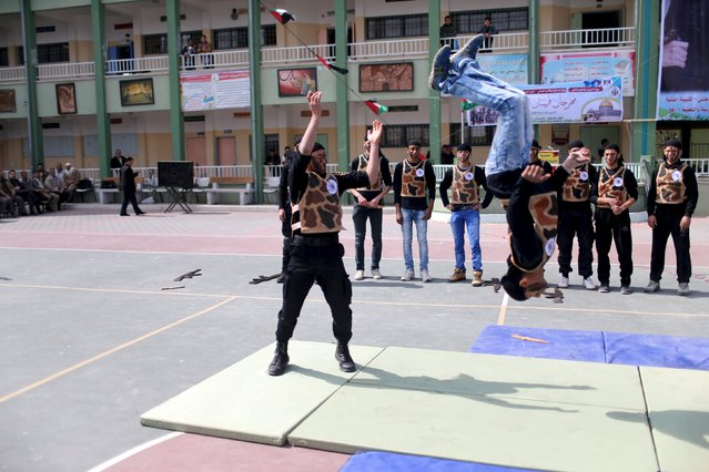 Palestinian students demonstrate their skills during a military-style show at a school in Rafah in the southern Gaza Strip March 28, 2016. (Photo by Ibraheem Abu Mustafa/Reuters)