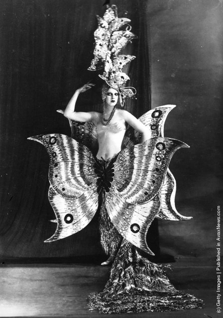 A cabaret dancer wearing a fantastic butterfly costume at the Folies Bergere theatre, Paris