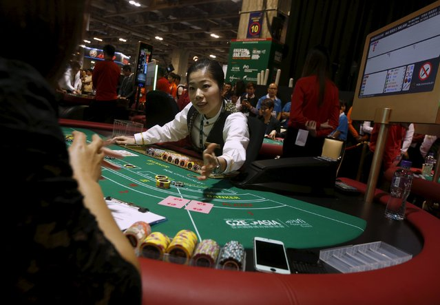 """May from Sands Macao competes in an """"All Asia Dealers Championship"""" at the Global Gaming Expo (G2E) Asia in Macau, China May 19, 2015. (Photo by Bobby Yip/Reuters)"""