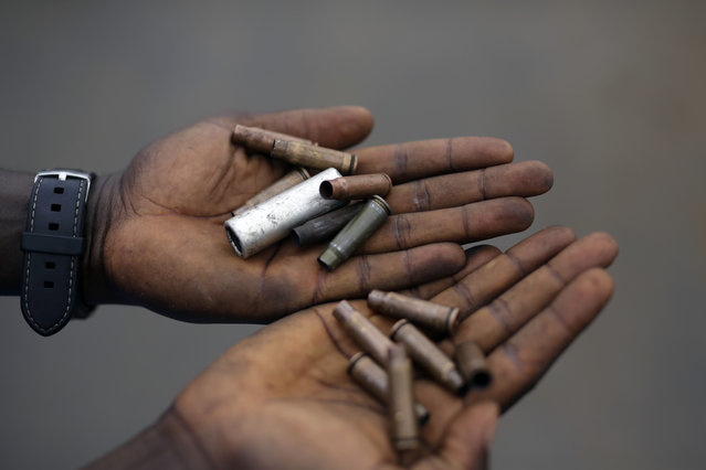 Demonstrators display cartridges from police guns fired in the Musaga neighborhood of Bujumbura, Burundi, Wednesday May 20, 2015. (Photo by Jerome Delay/AP Photo)