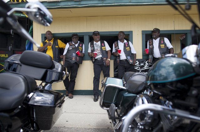 Members of the Sportsman Motorcycle Club of North Myrtle Beach, South Carolina check out the sights during the 2015 Atlantic Beach Memorial Day BikeFest in Atlantic Beach, South Carolina May 22, 2015. (Photo by Randall Hill/Reuters)