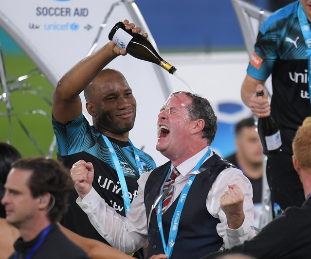 Didier Drogba and Piers Morgan during Soccer Aid 2019 at Stamford Bridge on June 16, 2019 in London, England. (Photo by David Fisher/Shutterstock)